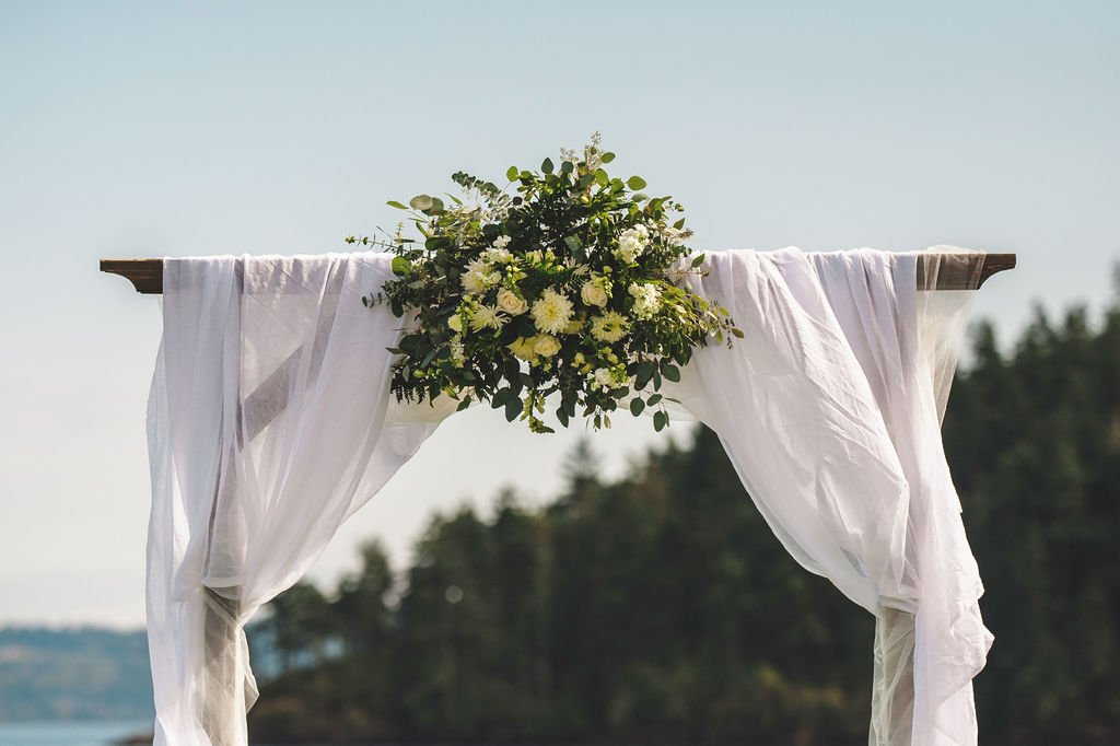 viking wedding arch, diy floral wedding arch, gauzy fabric wedding arch at. outdoor beach wedding in Pacific Northwest