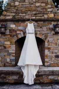 classic a line sophisticated wedding dress, high neckline, Seattle brides, long train wedding dress, hanging over fireplace