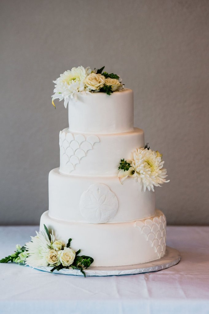 gorgeous beach themed wedding cake, navy green and white wedding, real flowers on wedding cake, scalloped wedding cake, fish scale wedding cake, sand dollar wedding cake, simple sophisticated wedding cake