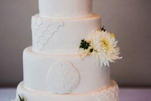 simple sophisticated wedding cake details, white and green wedding cake, real flowers wedding cake, scalloped wedding cake, fish scale wedding cake, sand dollar beach wedding cake