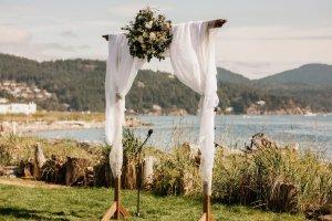 Pacific Northwest beach wedding, navy green and white wedding, outdoor wedding arch, diy wedding arch, hidden champagne wedding arch