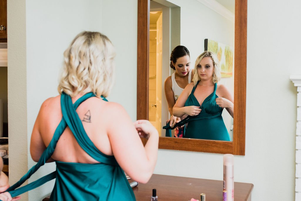 putting on bridesmaids dresses, emerald green bridesmaids dresses