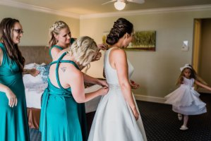 twisted bridal updo, bride and bridesmaids getting ready, wedding day preparations