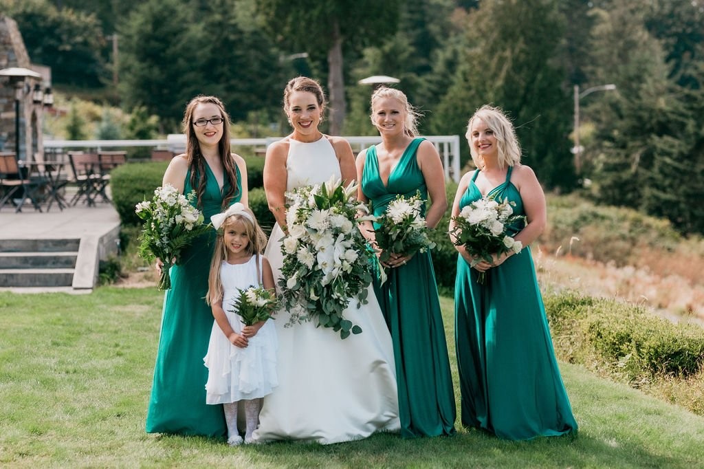 bride with bridesmaids and flower girl, convertible dresses, Lulus convertible dresses, emerald bridesmaids dresses, green and white wedding