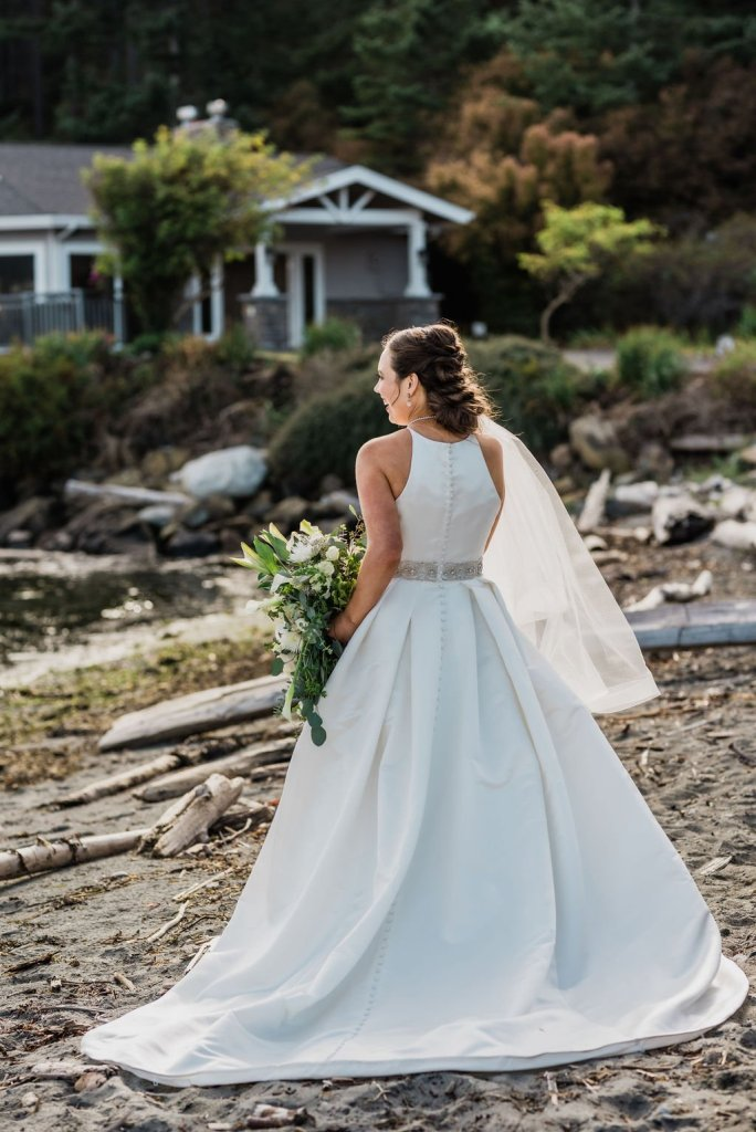 bride in classic a line wedding dress on beach, white and green wedding bouquet, fingertip length veil, Pacific Northwest wedding portraits