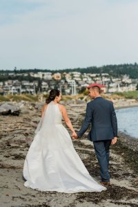 bride and groom walking on Pacific Northwest beach