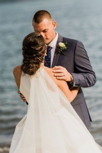 twisted up do, wedding hair ideas, bride and groom on beach