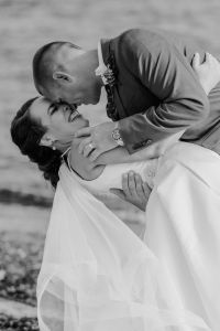 bride laughing, groom dipping bride on beach, tag heuer watch grooms gift, fingertip length veil, Pacific Northwest wedding portraits, black and white wedding photography