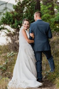 bride smiling, holding grooms arm, must have wedding shot list, outdoor wedding forest