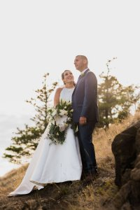 bride looking at groom, groom looking out over mountain, Pacific Northwest wedding
