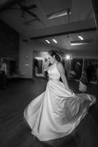 bride twirling in a line wedding dress