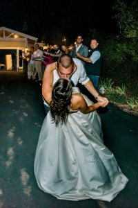 sparkler exit outdoor beach wedding Washington state pacific Northwest wedding kiss and dip