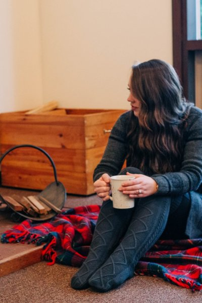 girls weekend camp Huston women's getaway weekend cabin in the mountains fireplace, mug, Pendleton plaid blanket