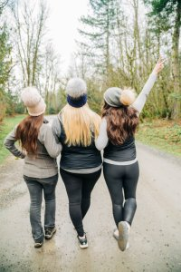 three friends at cabin in the mountains Washington state girls weekend