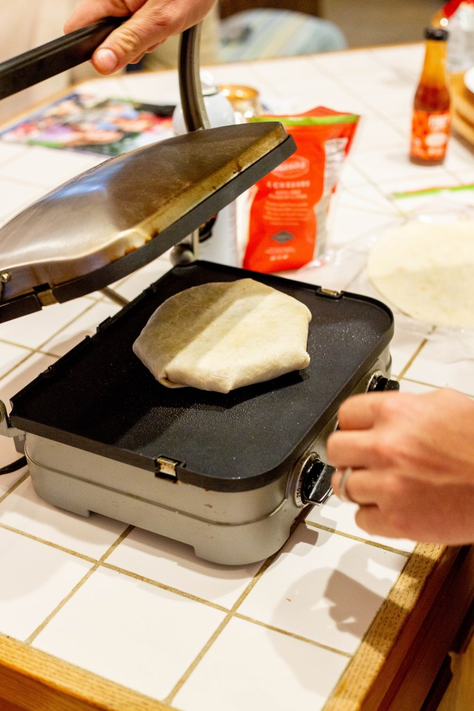 how to make a Crunchwrap with a griddle press