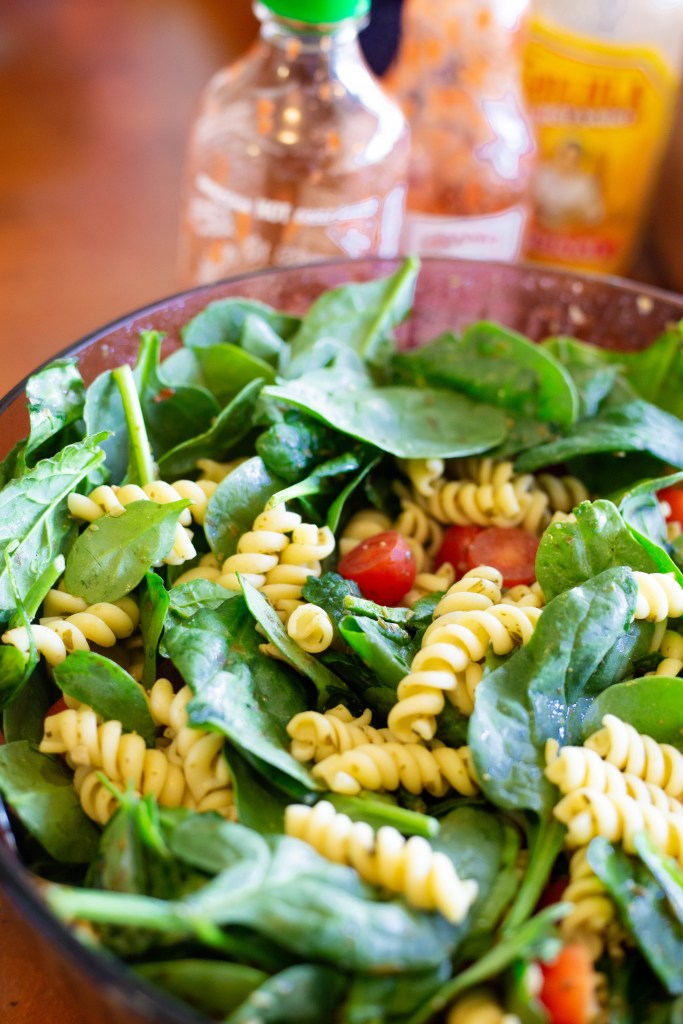 fresh pasta salad with spinach and tomatoes
