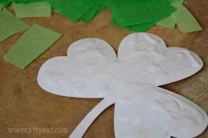 Spread glue on shape for tissue paper