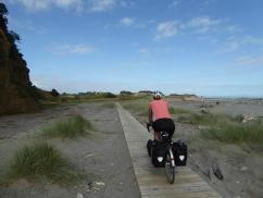 Philippa riding the beach trail outside the campsite