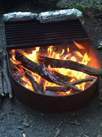 Cooking garlic bread on our campfire