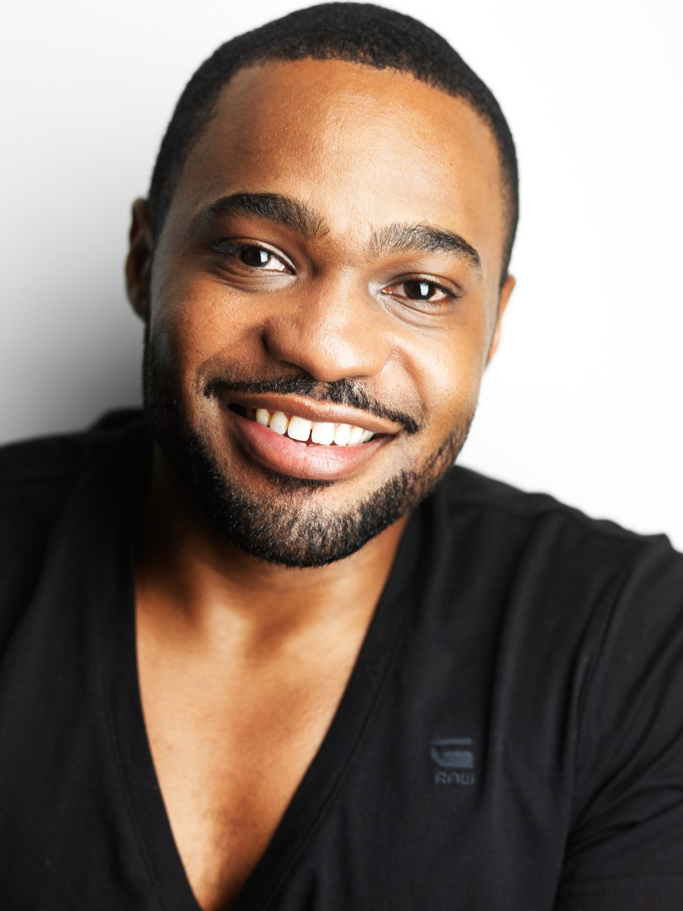 Headshot of Tyrone Smith wearing G-Star Raw & La Prairie shot by Jeffrey Mosier Photography 1000 Dean St Brroklyn, NY