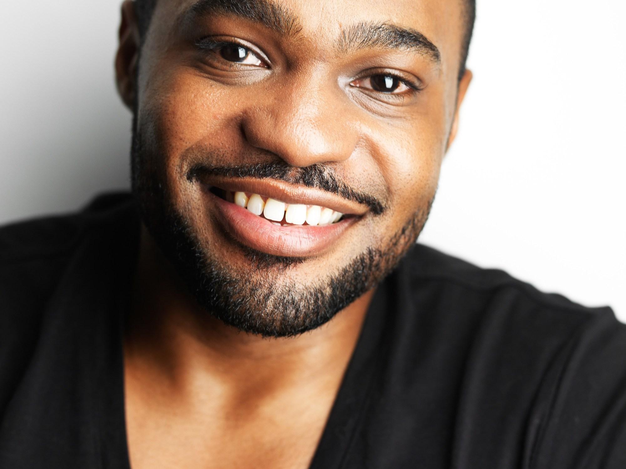 Headshot of Tyrone Smith wearing G-Star Raw & La Prairie shot by Jeffrey Mosier Photography 1000 Dean St Brroklyn, NY