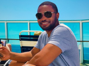 Royal Caribbean Rhapsody of the Seas with celebrity music producer influencer Tyrone Smith wearing gap, laprairie, and louis vuitton