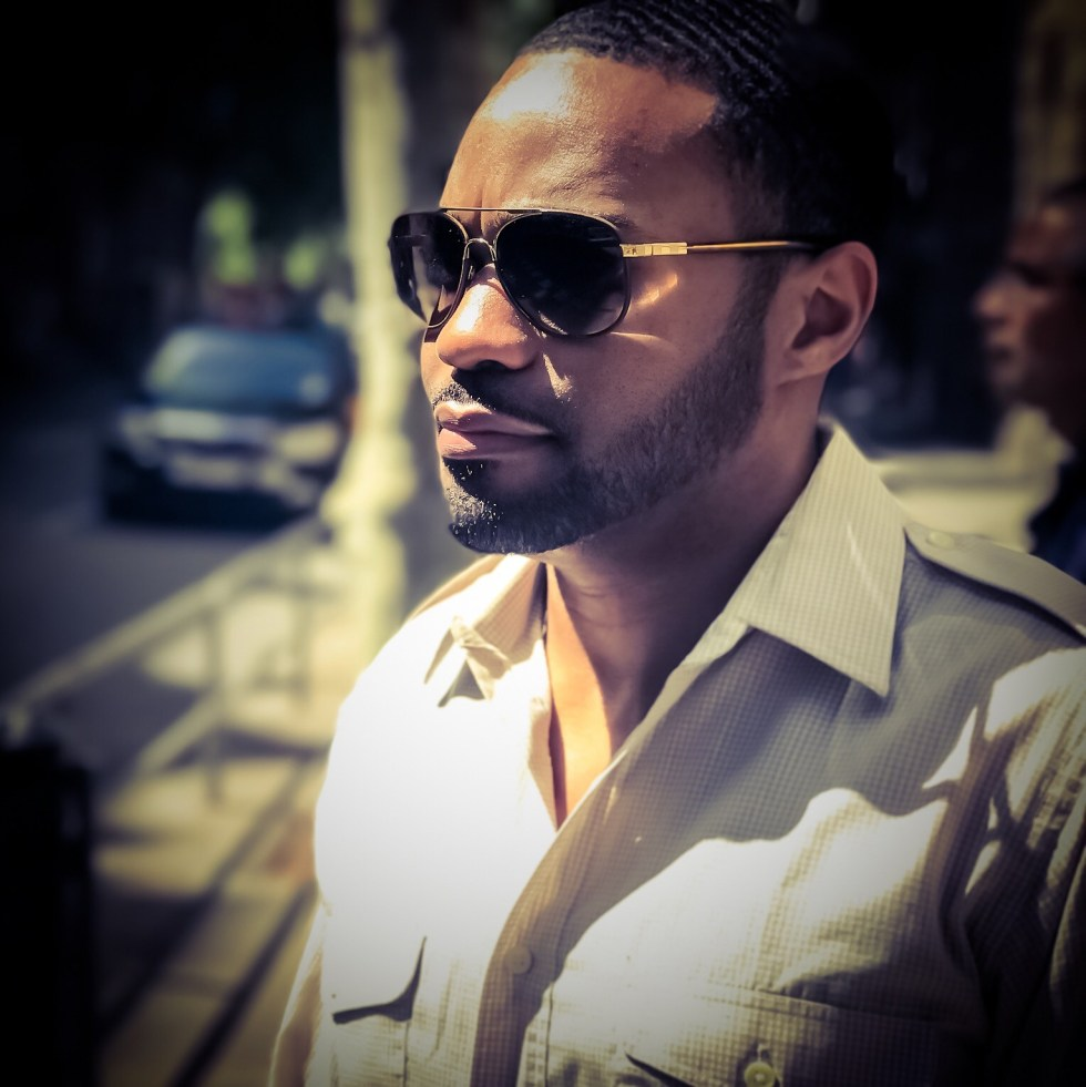 Christian Dior worn in Barcelona Spain by celebrity music producer social digital influencer Tyrone Smith with Louis Vuitton shades La Prairie products