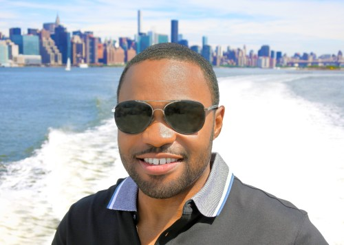 East River Ferry in Manhattan New York with celebrity Tyrone Smith music producer social digital influencer wearing Banana Republic Louis Vuitton LaPrairie