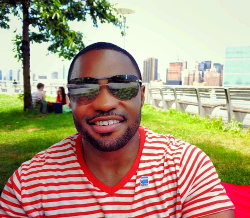 4th of July in Gantry Plaza Park NYC with Tyrone Smith wearing G-Star Raw shirt Louis Vuitton shades La Prairie facial products