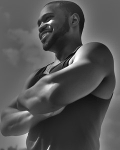 G-Star Raw Tank worn by Tyrone Smith smiling in the sun