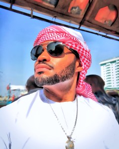 Old Dubai UAE gold souk with famous celebrity music producer Tyrone Smith mens fashion influencer wearing Louis Vuitton LaPrairie Avianne co jewlery