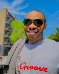 1 person, smiling, Tyrone Smith, 0000000466897877, T's Groove Inc, NYC, New York City, and sunglasses