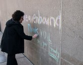 A woman who asked to remain anonymous noticed a chalk message fading to the late former mayor, and pulled out her own chalk to touch up the message.