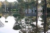 Still flood waters surround houses, mailboxes and shrubs in the neighborhood behind Bynum Elementary School in Kinston, N.C. almost a week after Hurricane Matthew made landfall.