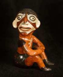 """A Canelos Quichua ceramic figurine depicting the Shiwai supai warmi. Made by Esthela (Estela) Dagua, Puyo. Shiwai supai is a very dangerous spirit, and especially so in feminine form. Very few potters depict such figures from the dangerous spirit world."" Dr. Norman Whitten."