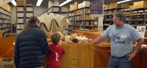 Tom Watters with visitors at the Mollusc collection. 2011