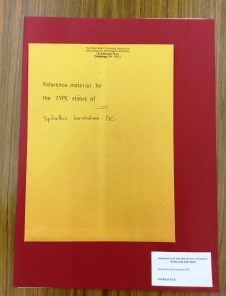 An envelope containing reference literature about the type specimen.