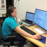 Kira Edic showing bird sounds on a computer