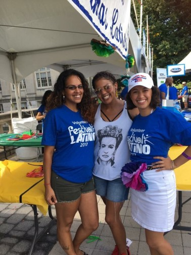 Cáceres volunteering with fellow LMA hermanas at the Festival Latino with the Damas Latinas paper flower booth.