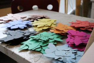 The sheets of paper turned into stacks of colorful butterflies and dragonflies.