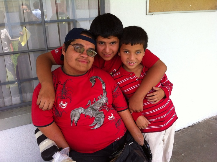 Ludwin with his two brothers.