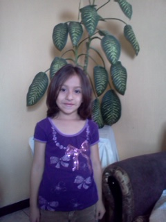Alejandra is a sweet little girl who loves coloring books.
