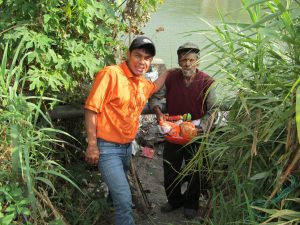 This visit really touched our hearts!  This was the first time we had met this man and the rocks you see behind him are where he has made his home.  He has no family to live with and survives by catching bait in the river and selling it to fishermen.  What a blessing it was to be able to share with him!