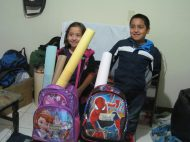 Alejandra was so excited with her princess backpack and Jairo couldn't wait to use his Spiderman backpack