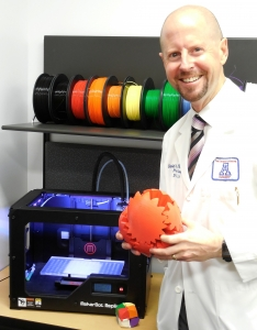 Armstrong with output from the SALSA Replicator Lab, run by Dr. Nick Giovinco. The replicator lab is exploring technique development in the low-cost printing of physical tools, training templates and biologics in medicine and surgery.