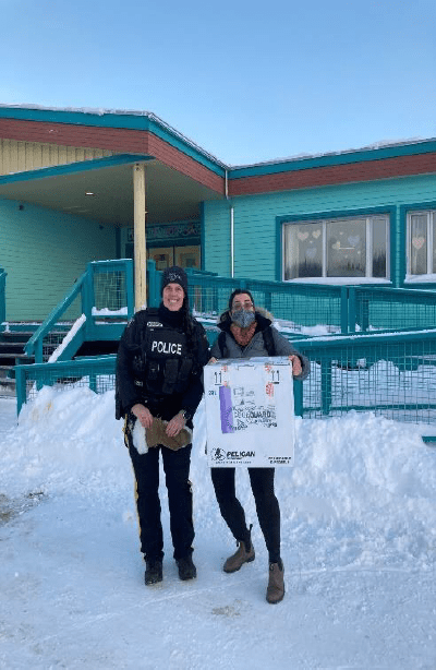 Nurse in Charge Ann Chapman and a local RCMP officer safely transport the Moderna vaccine to Chief Zzeh Gittlit School, the vaccination clinic venue in Old Crow. Text & Photos Credit: K.H., Yukon, Community Services.