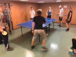 The expedition crew spent time unwinding with the ship's crew during a round robin ping pong match.
