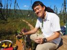 Volunteer Akira Hama from Chiba University holds the birch shrubs used to estimate the leaf area index of the boreal forest.