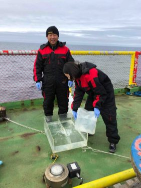 Naeun Jo and Kwanwoo Kim preparing an incubator for the phytoplankton.