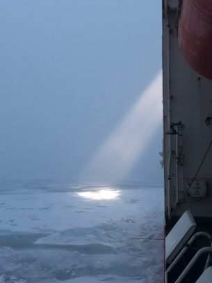 The ship's spotlight looking for a strong ice floe.